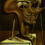 Salvador Dalì - Salvador Dalì Autoritratto molle con pancetta fritta Soft Self Portrait with Grilled Bacon  1941 Olio su tela 61 x 51 cm Collezione Fundació Gala-Salvador Dalí, Figueres © Salvador Dalí, Fundació Gala-Salvador Dalí, SIAE, Roma, 2012