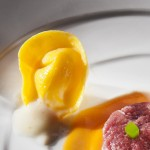 Tortellini with Parmisan, tomato sauce and raw meat - CR. Francesca Brambilla & Serena Serrani