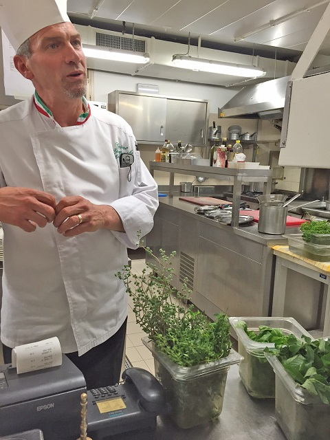 Chef Cosimo and herbs - Photo by Margie Miklas