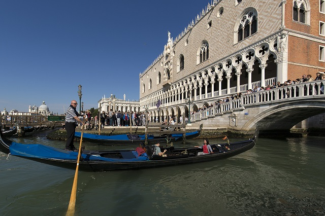 Gondolier in Venice Photo by Michael David