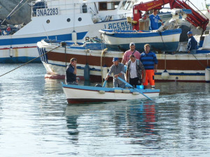 Fishermen coming in from a long night at work